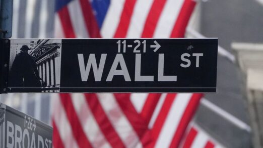 FILE PHOTO: A U.S flag is seen on the New York Stock Exchange in the Manhattan borough of New York City